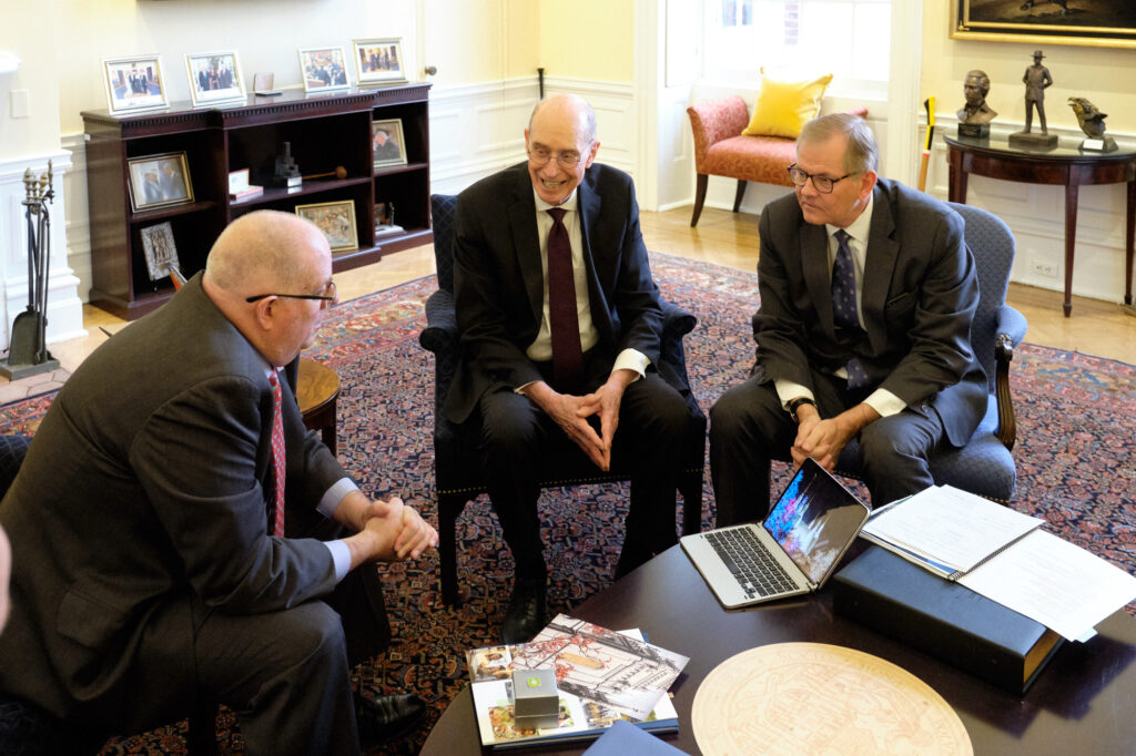President Henry B. Eyring and Elder Gary E. Stevenson speak with Maryland Governor Larry Hogan on Nov. 15, 2019, about the upcoming public open house of the Washington D.C. Temple.