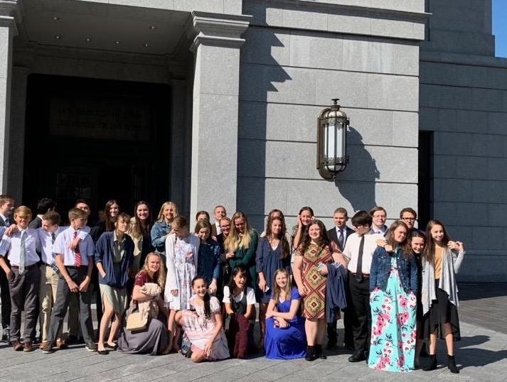 Youth from Maryland's Broadneck Ward gather outside the Philadelphia Temple. The young women and young men have claimed opportunities to serve in the Philadelphia temple during the renovation of the Washington D.C. Temple