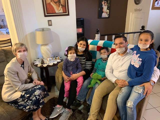 Sister Jean B. Bingham, left, visits with the Carrillo family during a visit to Mexico in December 2019. The Carrillo family's youngest daughter was recently diagnosed with leukemia.