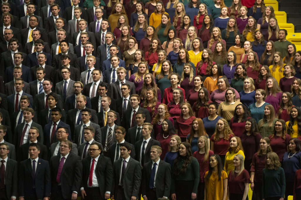The Utah Valley Institute Choir sings during a worldwide devotional broadcast from the UCCU Center at Utah Valley University in Orem on Sunday, Jan. 12, 2020.