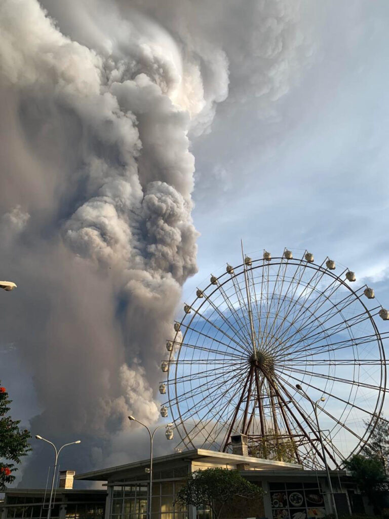 In this Jan. 12, 2020, photo, Taal volcano releases ash and smoke during an eruption in Tagaytay, Cavite province south of Manila, Philippines.