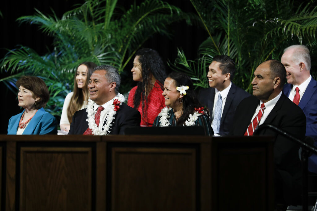Elder Vai Sikahema sits on the stand during the first campus devotional of the new year at BYU-Hawaii on Tuesday, Jan. 14, 2020.
