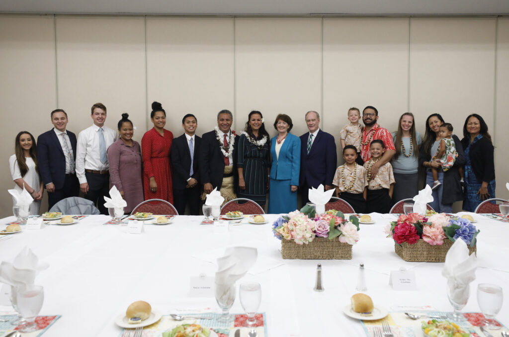 Elder Vai Sikahema, center, poses for a photo with attendees at a special luncheon following a campus devotional at BYU-Hawaii on Tuesday, Jan. 14, 2020.