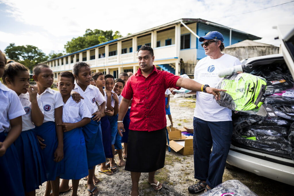 Rheumatic Relief volunteers distribute new backpacks, school supplies and books to primary school children in Samoa.
