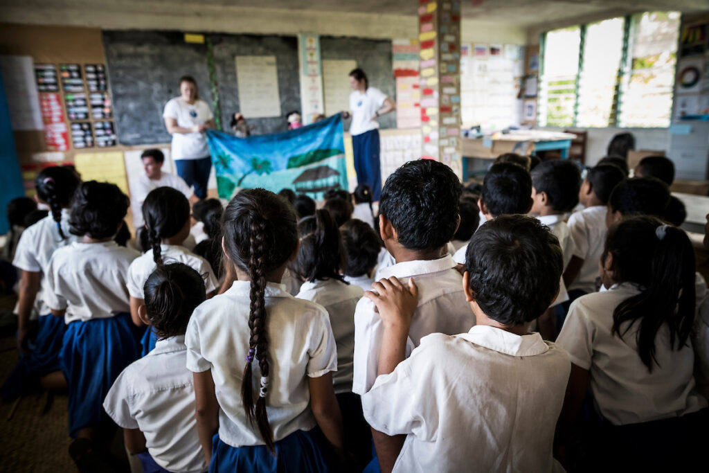 Student volunteers with the BYU program Rheumatic Relief put on a puppet show to teach children in Samoa about rheumatic heart disease.