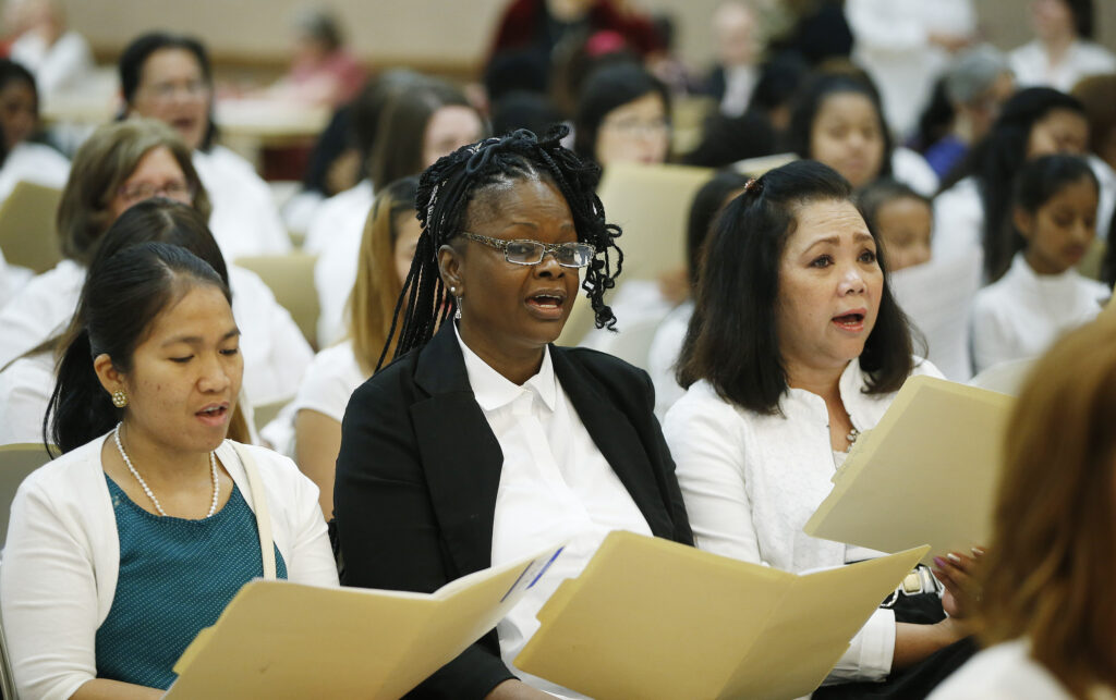 """A combined choir of women and girls from 50 countries practices for the 2016 general women's session of general conference. The """"unique"""" Saturday evening session of the April 2020 general conference will include music by a multicultural choir."""