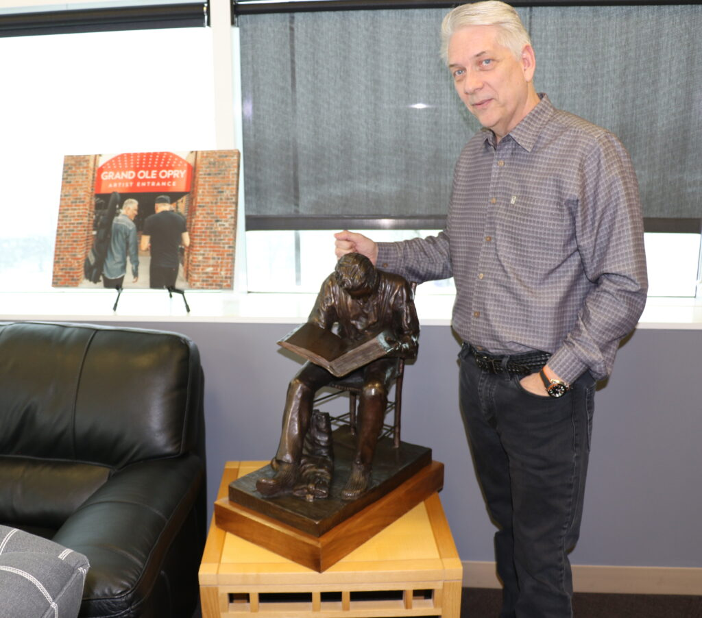 USANA CEO Kevin Guest's West Valley City, Utah, office includes a photo commemorating his performance at the Grand Ole Opry and a sculpture of young Joseph Smith seeking wisdom in the scriptures.