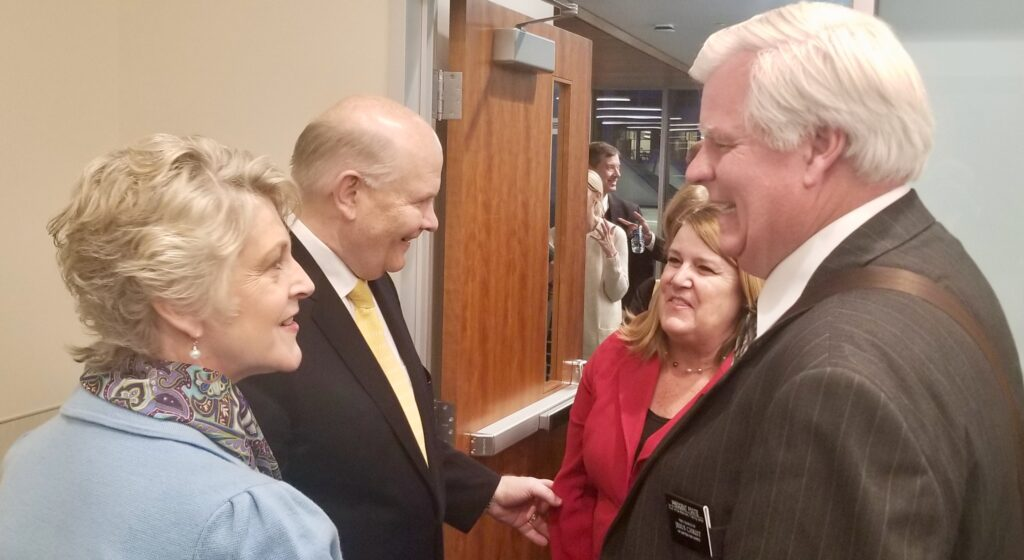 Elder Dale G. Renlund and Sister Ruth Renlund, left, greet President Raymon D. Foote and Sister Cindy Foote, new president and companion for the South Africa Missionary Training Center, as part of the 2020 MTC Leadership Seminar on Jan. 14, 2020, at the Provo Missionary Training Center in Provo, Utah.