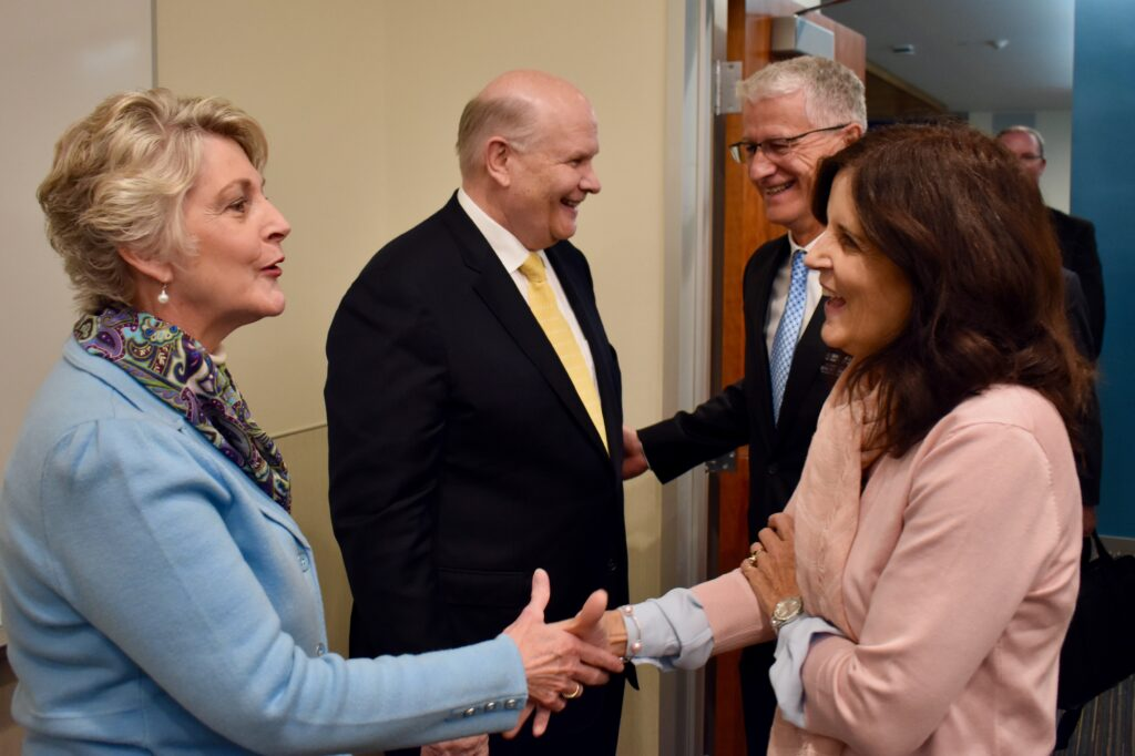 Elder Dale G. Renlund and Sister Ruth Renlund, left, greet, President Terry L. Wade and Sister Gina Wade, right, of the Peru Missionary Training Center at the Provo MTC on Jan. 14, 2020, as part of the 2020 MTC Leadership Seminar.