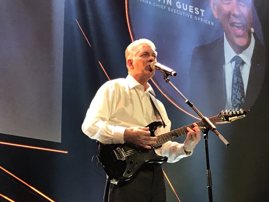 USANA CEO Kevin Guest shares his guitar talents during recent company convention.