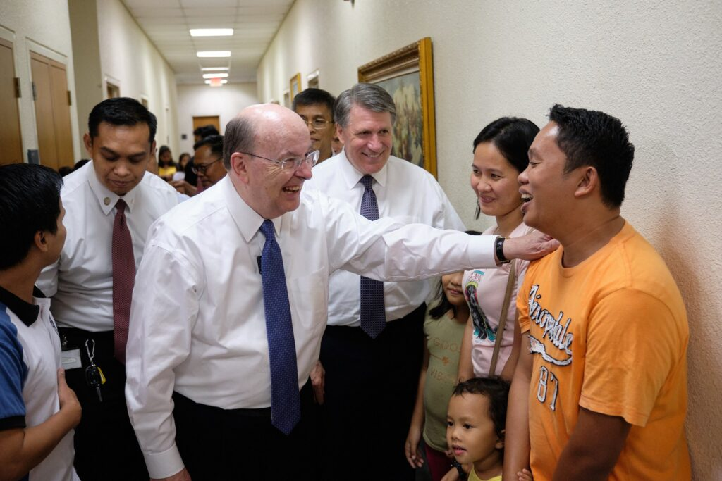 Elder Quentin L. Cook greets Latter-day Saints gathered at a local meetinghouse on Jan. 15, 2020, as the Taal Volcano continues to spew ash south of Manila, Philippines.