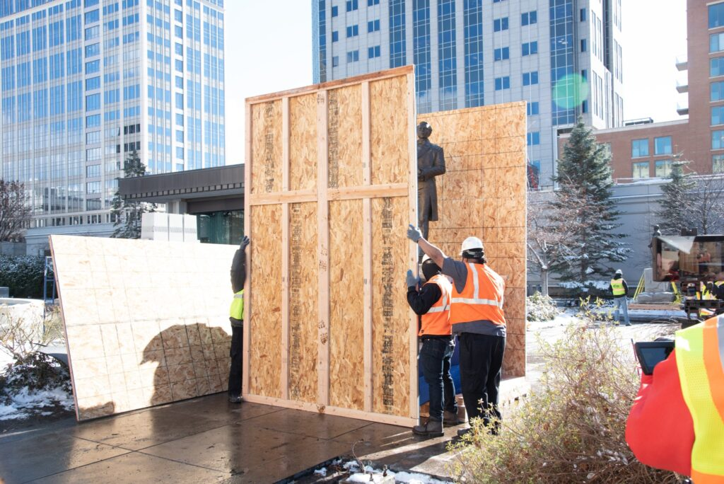 Statues on Temple Square are removed to be placed in storage in preparation for renovation on the Salt Lake Temple.