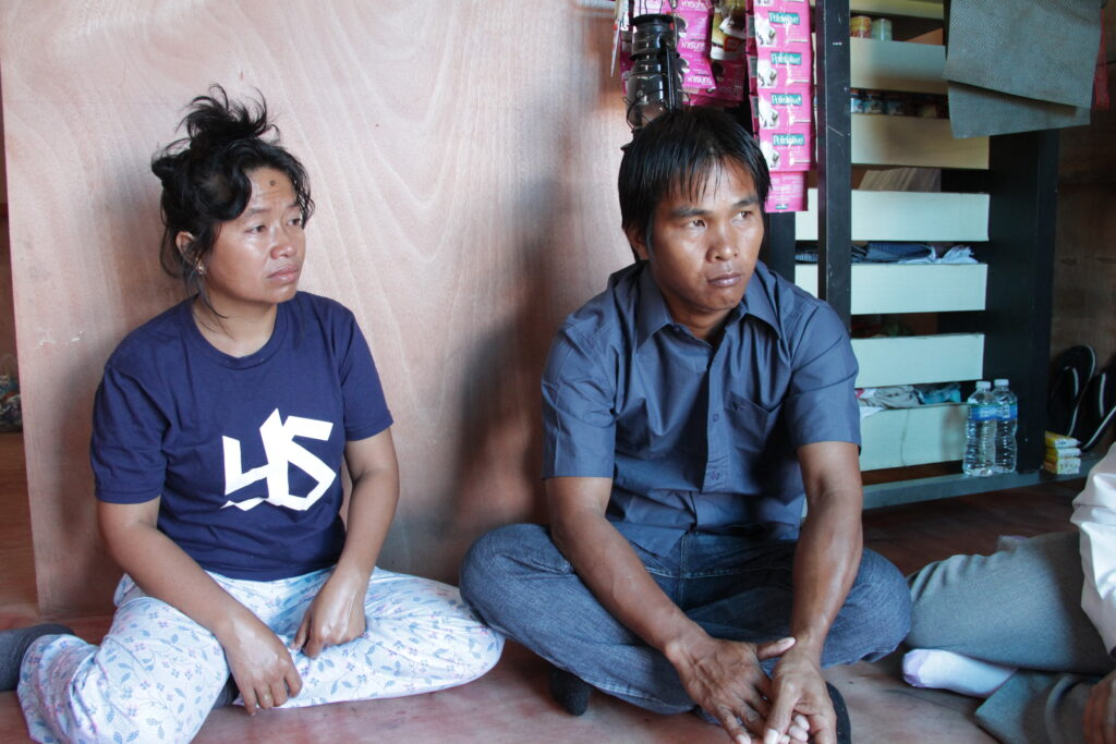 Gemmer Esperas and his wife, Analyn Esperas, sit in a new, sturdy house Gemmer constructed with help from The Church of Jesus Christ of Latter-day Saints.