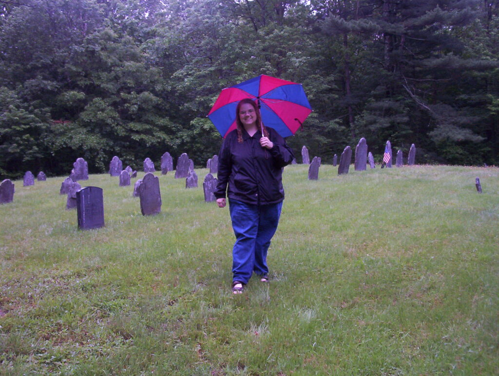 Christie Blair visits a cemetery in Easton, Bristol, Massachusetts during a family history trip in June 2003.
