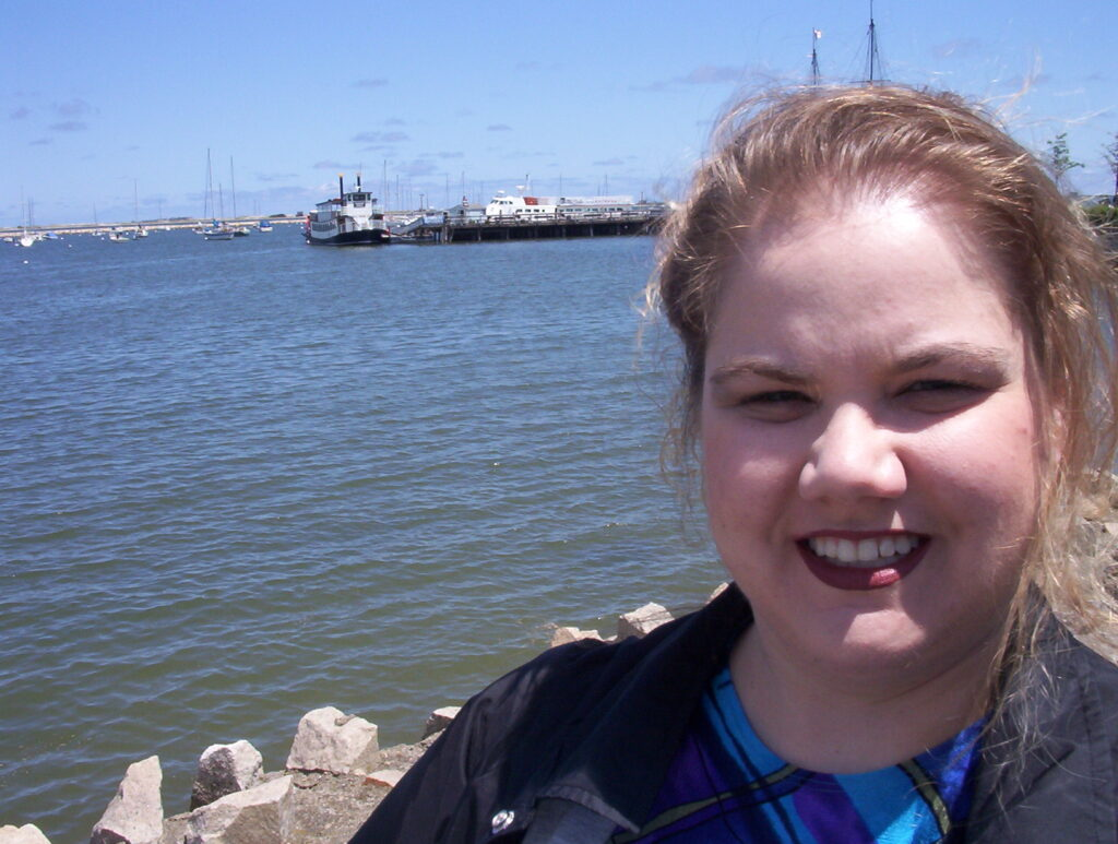 Christie Blair poses for a photo at the Plimoth Plantation during a family history trip in June 2003.