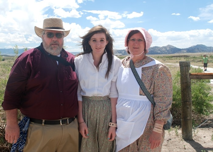 From left: Jeff Westover, his daughter Maggie, and his wife Sandy smile at Independence Rock in Wyoming, the first day of Trek in June 2013.
