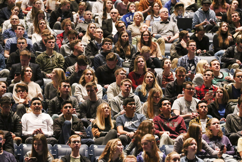 Attendees listen to Elder Ronald A. Rasband of the Quorum of the Twelve Apostles as he speaks during a Brigham Young University devotional at the Marriott Center in Provo, Utah, on Tuesday, Jan. 21, 2020.