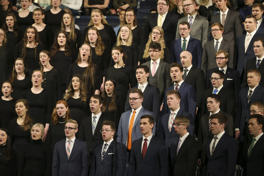 A choir sings during a Brigham Young University devotional at the Marriott Center in Provo, Utah, on Tuesday, Jan. 21, 2020.