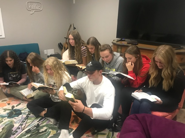 Teenagers participate in a student-led home scripture session in Draper, Utah.