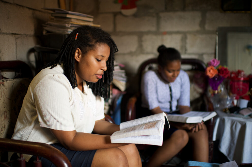 Two young women study the scriptures together.