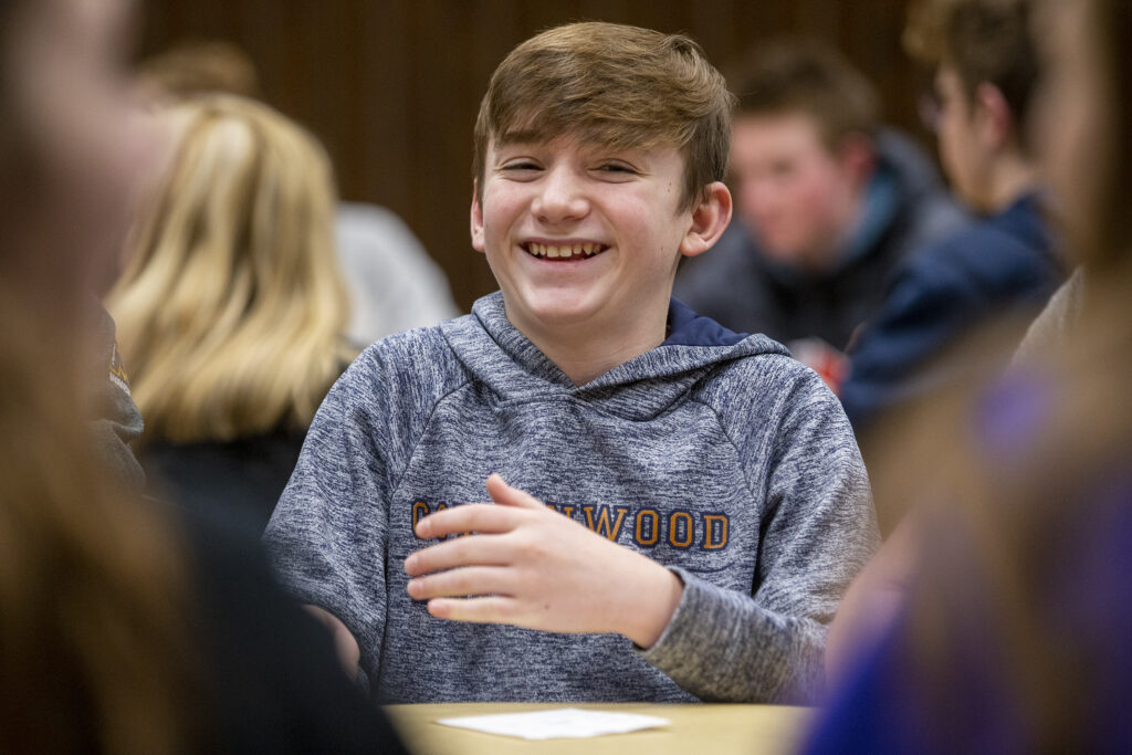 Tobin Hansen laughs as he and other youth in the Willow Creek 6th Ward in Sandy, Utah, gather to play games together on Wednesday, Jan. 22, 2020.