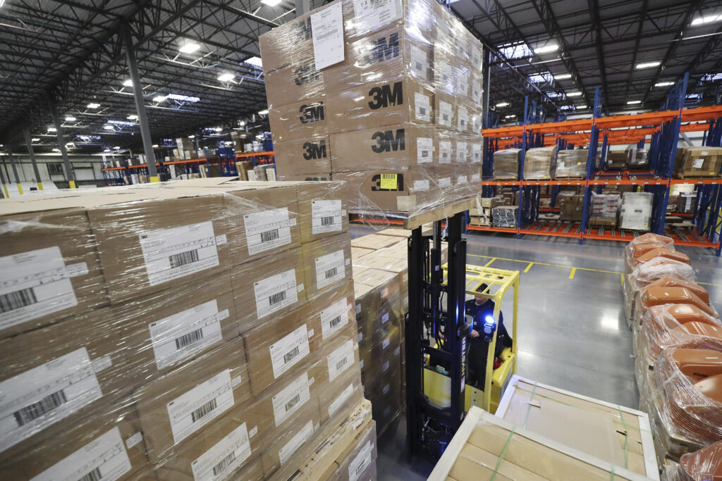 Warehouse workers load supplies as The Church of Jesus Christ of Latter-day Saints send aid to China in Salt Lake City on Wednesday, Jan. 29, 2020. Respirator masks, protective goggles and protective suits were sent.