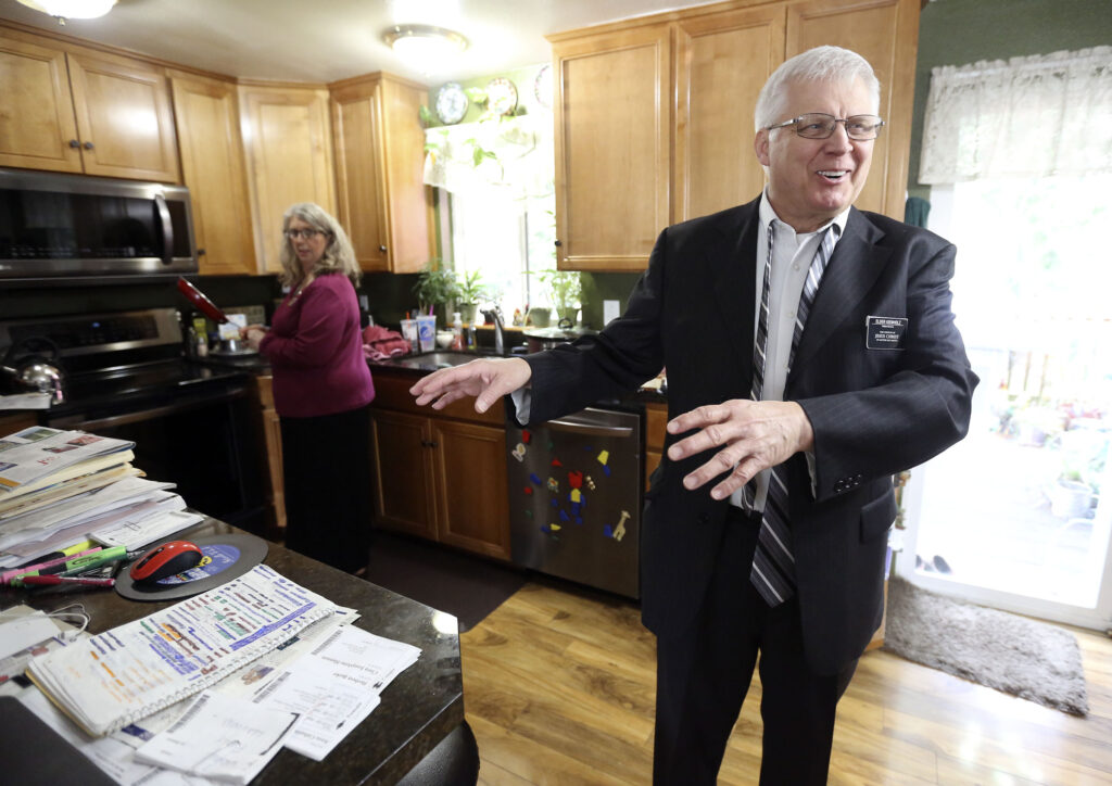 Diane and Steve Kienholz talk in their kitchen at home in Puyallup, Wash., on Sunday, Jan. 26, 2020.