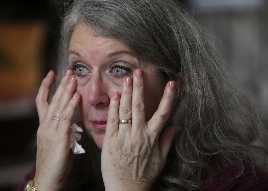 Diane Kienholz wipes tears from her eyes while talking about her work with the homeless population at home in Puyallup, Wash., on Sunday, Jan. 26, 2020.