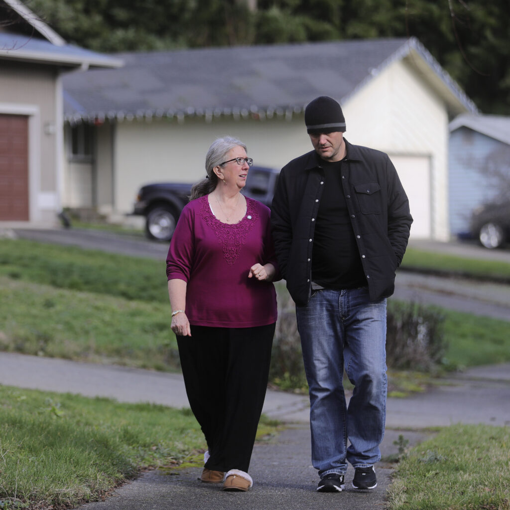 Diane Kienholz walks with her son Jesse Kinman in Puyallup, Wash., on Sunday, Jan. 26, 2020.