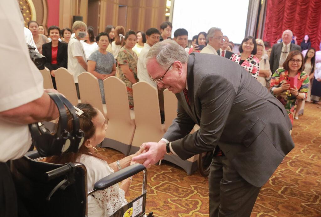 Elder Neil L. Andersen greets Church members during a member meeting in Bangkok, Thailand, on Jan. 12, 2020.