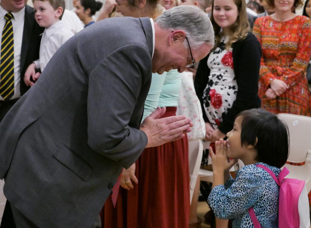 Elder Neil L. Andersen greets members during a member meeting in Bangkok, Thailand, on Jan. 12, 2020.