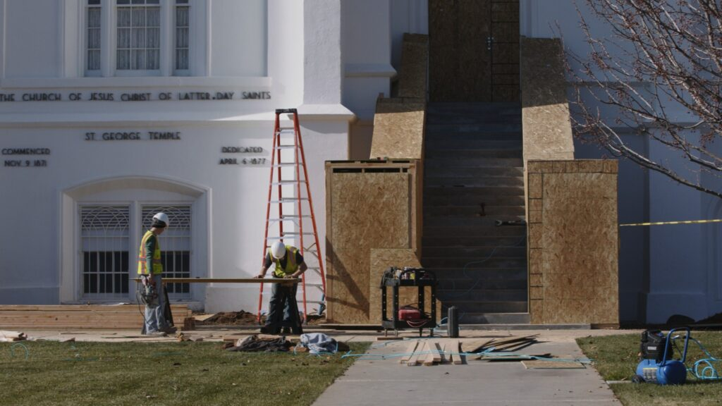 Workers build protective covers on areas of the St. George Utah Temple during its renovation in January 2020. Renovations are projected to be completed by 2022.