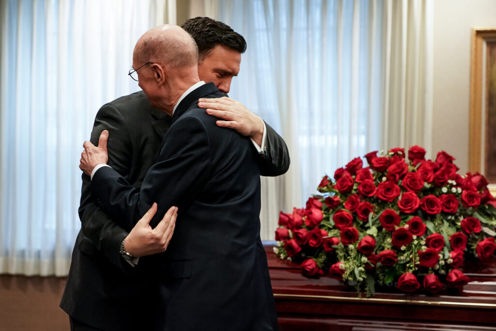 President Henry B. Eyring, second counselor in the First Presidency of The Church of Jesus Christ of Latter-day Saints, right, greets Michael Christensen during a viewing before the funeral of his father, Clayton Christensen, at a Cambridge, Massachusetts, chapel on Saturday, Feb. 1, 2020.