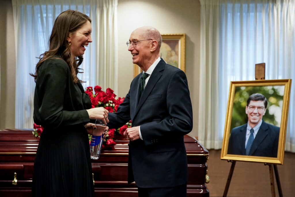 President Henry B. Eyring, second counselor in the First Presidency of The Church of Jesus Christ of Latter-day Saints, greets Kate Christensen during a viewing before the funeral of her father, Clayton Christensen, at a Cambridge, Massachusetts, chapel on Saturday, Feb. 1, 2020.