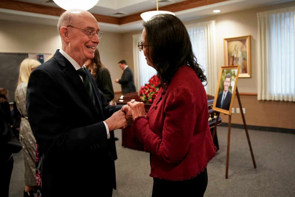 President Henry B. Eyring, second counselor in the First Presidency of The Church of Jesus Christ of Latter-day Saints, greets Christine Christensen before the funeral service for her husband, Clayton Christensen, at a Cambridge, Massachusetts, chapel on Saturday, Feb. 1, 2020.