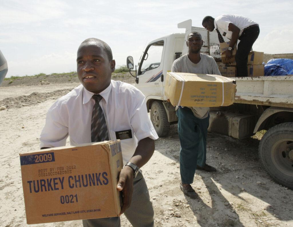 Church missionaries Elder Sammuel Bassette, left, and Elder Lgune Raymond unload supplies for victims of the earthquake in Port-au-Prince, Haiti, on Jan. 20, 2010.