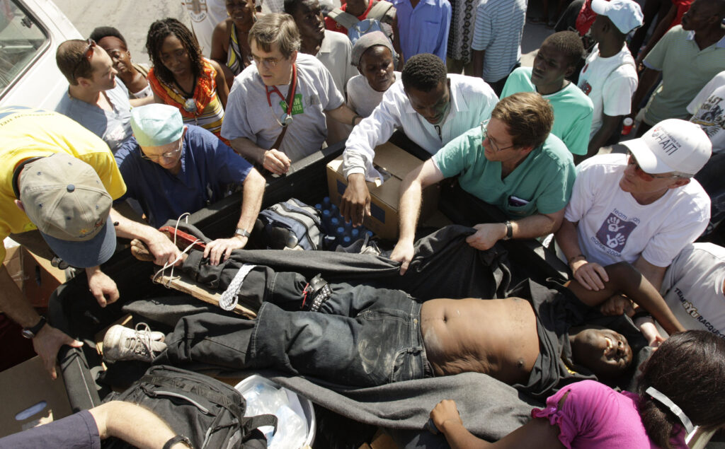 Latter-day Saint doctors from Utah and across the United States — in Haiti to help treat victims of the devastating Jan. 12, 2010, earthquake — care for and transport a man they came across that was hit by a bus in the streets in Port-au-Prince, Haiti, on Jan. 22, 2010.