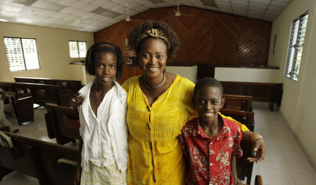 Pétion-Ville Ward members Nadine Dely and her children McElliott and Nashnaydine stand in the chapel after church services in Port-au-Prince, Haiti, on Sunday, Jan. 24, 2010. They lost their home in the Jan. 12 earthquake and were residing temporarily on the meetinghouse grounds.