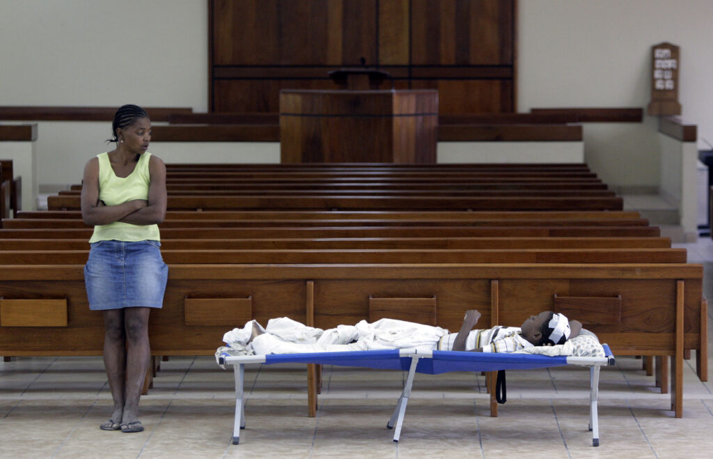 Marie Miento Picard watches over her son Rotchil after he is cared for at the Croix-des-Missions meetinghouse in Port-au-Prince, Haiti, on Jan. 25, 2010.