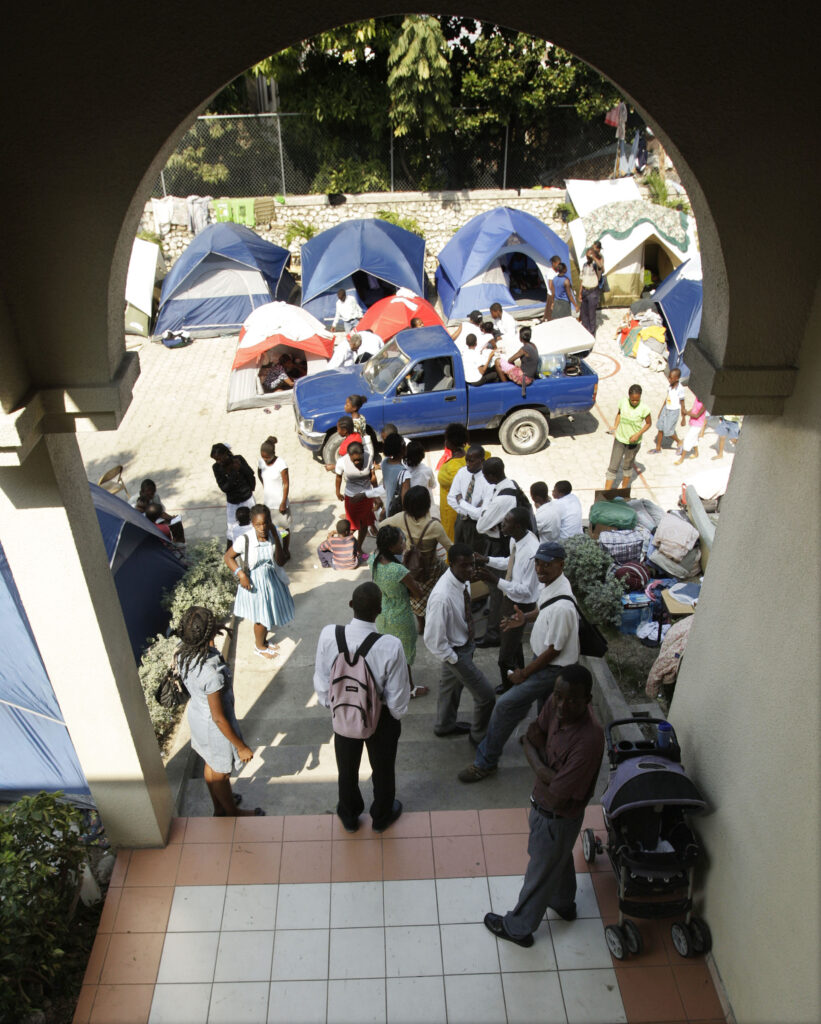 Latter-day Saints leave the Petionville Ward after Church meetings in Port-au-Prince, Haiti, January 24, 2010. Many were residing on the grounds because they had no homes due to the earthquake.