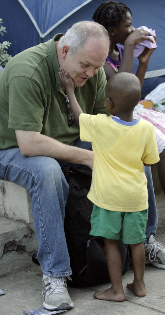 Deseret News and Church News reporter Scott Taylor talks with with a young Haitian in Port-au-Prince, Haiti, Wednesday, Jan. 20, 2010.