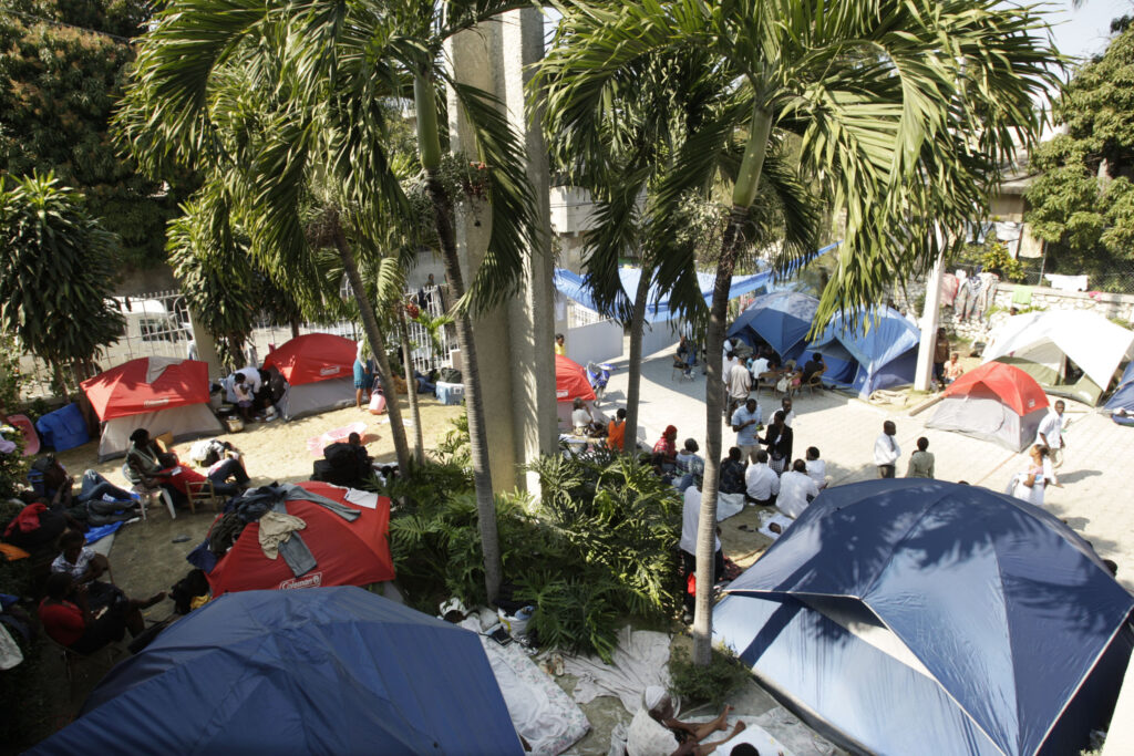 Earthquake victims set up temporary shelter at the Pétion-Ville meetinghouse grounds in Port-Au-Prince, Haiti, on Jan. 24, 2010.