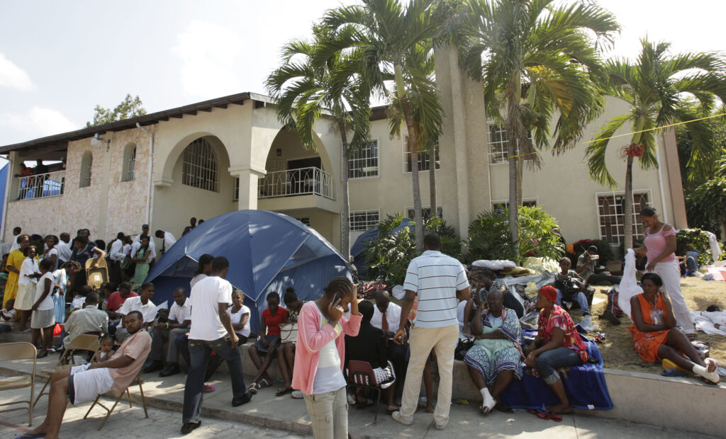 Earthquake victims set up temporary shelter at the Pétion-Ville meetinghouse grounds in Port-Au-Prince, Haiti, on January 24, 2010.