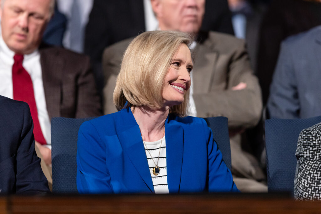 Young Women general president Sister Bonnie H. Cordon smiles from the podium prior to speaking at a Brigham Young University devotional in the Marriott Center on campus Feb. 4, 2020.