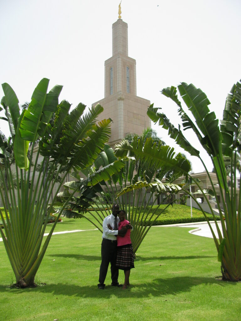 Jean Rossely and Nadege Bernard pose outside the Santo Domingo Dominican Republic Temple, where they were sealed on July 7, 2010.