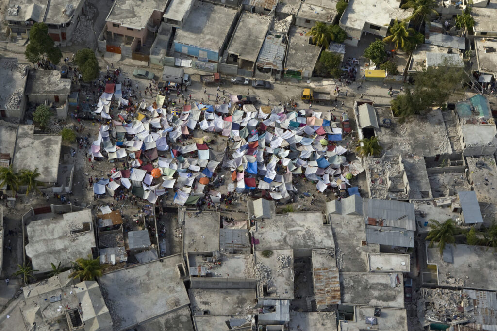Haitians set up impromptu tent cities in the capital after a magnitude 7.0 earthquake hit Port-au-Prince on Jan. 12, 2010.