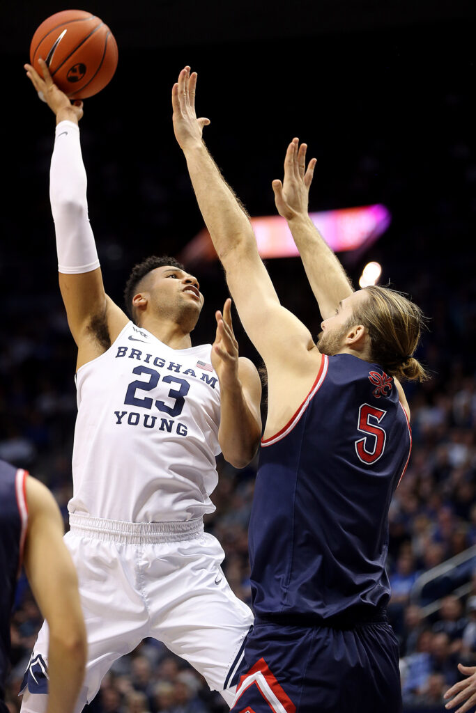 BYU Cougars forward Yoeli Childs (23) puts up a shot over Saint Mary's Gaels center Jock Perry (5) as BYU and Saint Mary's play in an NCAA basketball game in Provo at the Marriott Center on Saturday, Feb. 1, 2020.