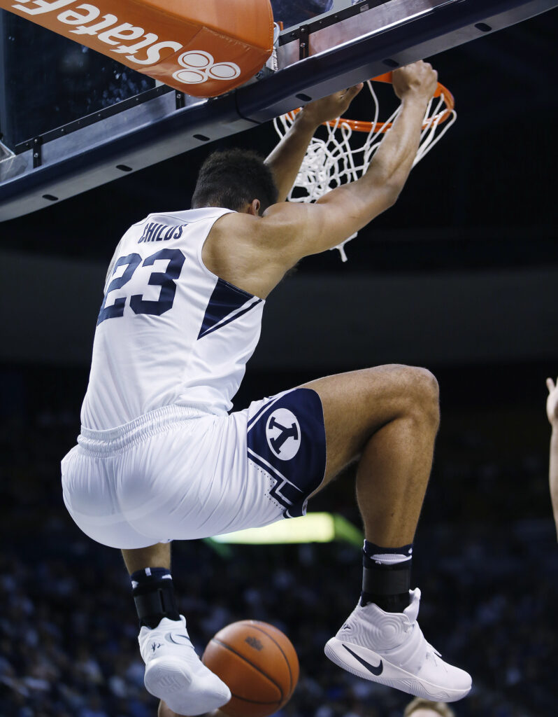 Brigham Young Cougars forward Yoeli Childs (23) slams on the San Diego Toreros in Provo on Thursday, Feb. 16, 2017.