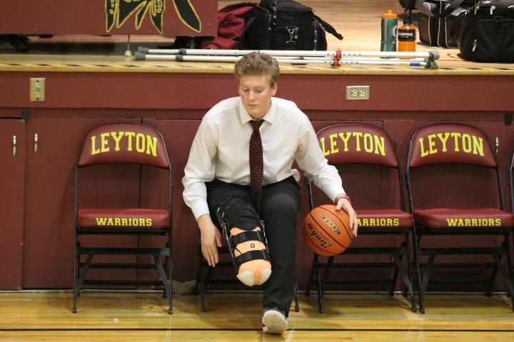 After part of his right leg was amputated following a football injury, Drew Haley had to support his high school basketball team from the bench.