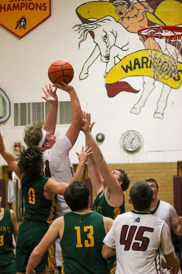 Drew Haley leaps on his prosthetic leg to score a basket for Nebraska's Leyton High School.